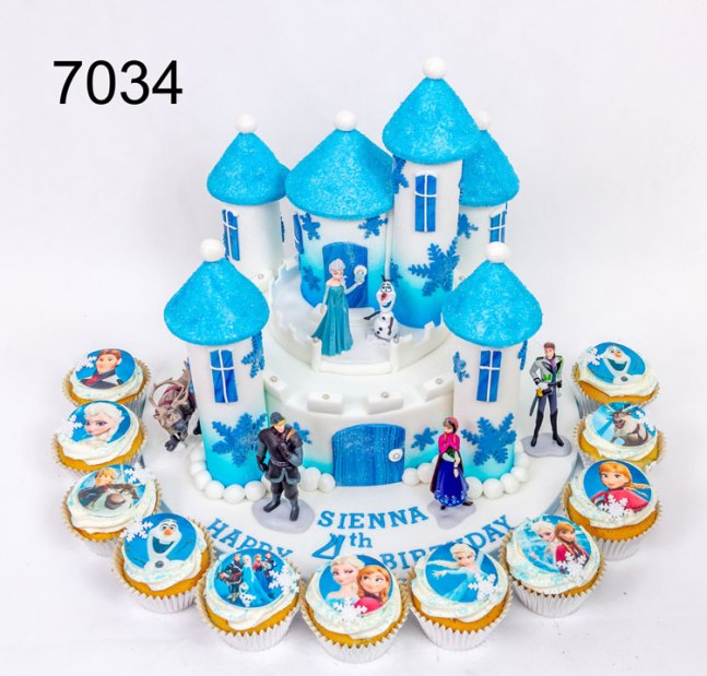 7034 7034 White & blue sparkly Frozen castle, with Frozen figures. plus frozen themed cupcakes