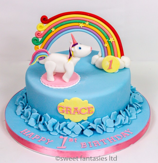 Unicorn with rainbow, pale blue girls birthday cake. cakes by sweet fantasies