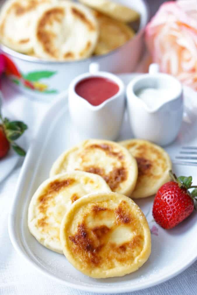 The Baked Syrniki are the healthified version of the Russian Traditional Syrnikis, usually pan-friend in oil. The Baked Syrnikis are just as yummy and scrumptious, but healthier and lower in calories! They make a perfect high-protein (naturally) breakfast, dessert or snack, paired with the Healthy Fresh Strawberry Sauce!