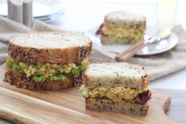 Curried no egg sandwich is a simple lunch idea that's packed with protein. Toss the ingredients in a bowl, mash them with a fork and spread on bread.