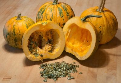 Canning, Cooking, or Jack-o-Lantern? Learn how to select the best pumpkins and gourds with this buying guide. #Canning #Cooking #JackoLantern #Pumpkin #Baking #Food #Halloween #Thanksgiving #Pie #PumpkinPie #Dessert #Shopping #BuyingGuide #HowTo - Naked Seeded Pepitas