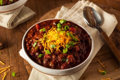 My Weight Loss Journal - Bowl of Game Day Chili with Cheese and Green Onion on Top