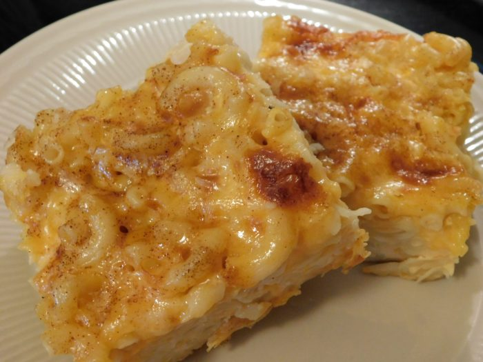 The Best Baked Macaroni and Cheese EVER! The addition of eggs, evaporated milk, eggs, butter, and mustard powder in its recipe gives this custard-style baked Macaroni and Cheese dish lots of cheesy gooey goodness. #holiday #cooking #Recipe #Easter #Christmas #Thanksgiving