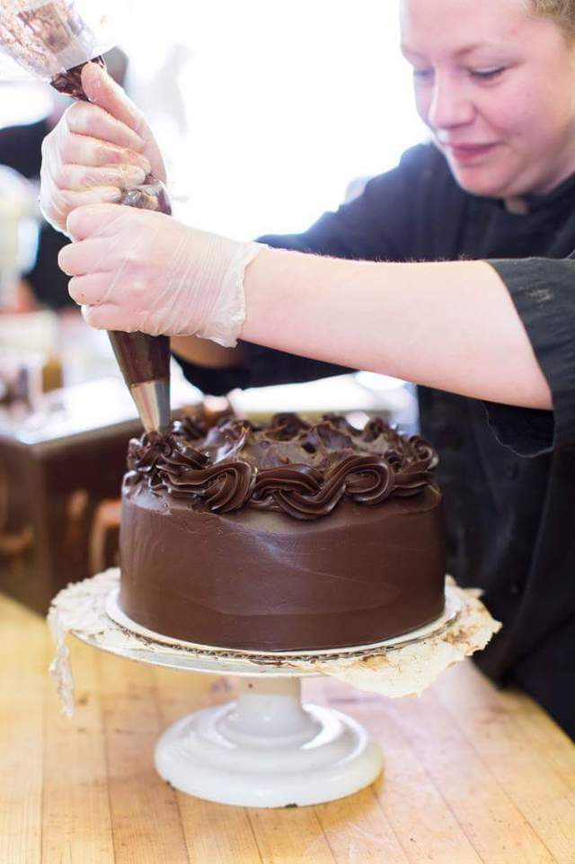 The Pastry Chef Creating the Chocolate Fudge Cake Photo is from the Well Bred Facebook Page from 16 Dec 15