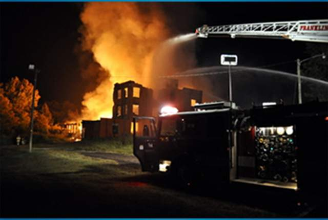A Fire Sweeps Through the Old Textile Mill/Photo by Greta Lint @ The Courier Tribune