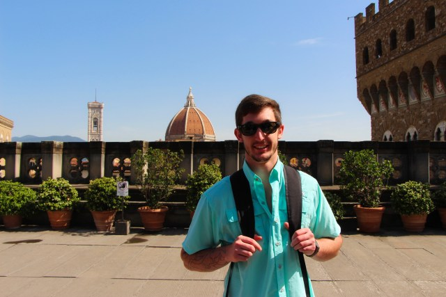 Juston on a sunny rooftop in Florence.