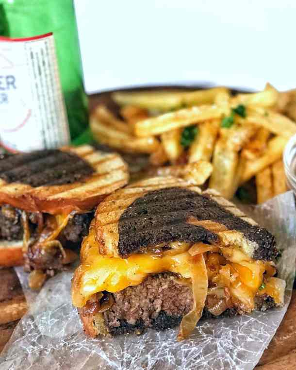Patty melt cross section with homemade crispy french fries on www.sweetteaandthyme.com Never just a simple sandwich, the best patty melt is this all-American classic. Juicy, well-seasoned beef patties, melty cheddar and provolone cheese, sweet caramelized onions, all sandwiched between two well-buttered and flavorful slices of rye bread. Slather on your favorite spread, serve with crispy, homemade fries, and you've got a true diner classic.