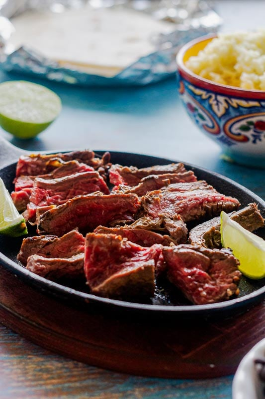 quick and easy carne asada sliced up in preparation for tacos or burritos