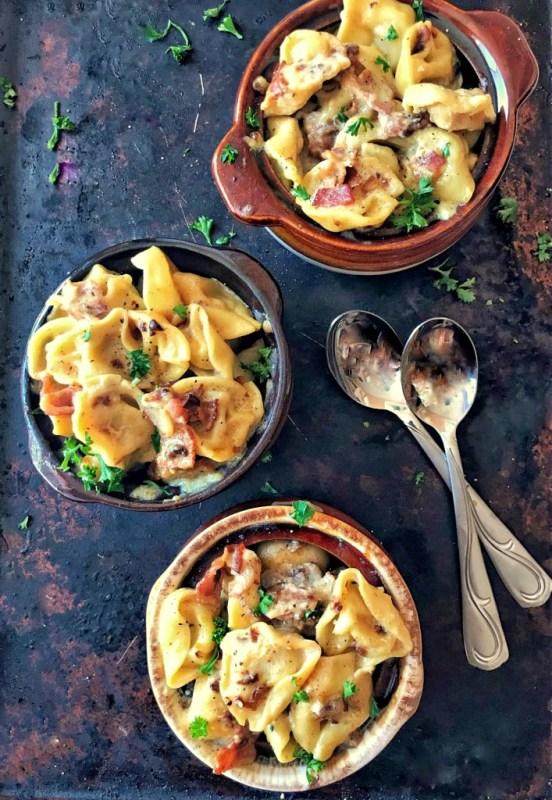 overhead shot of three bowls of tortellini with bacon cream sauce on Sweet Tea & Thyme