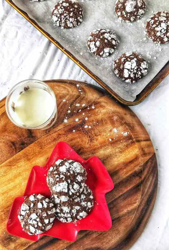 Classic chocolate crinkle cookies are perfect for the holidays! Soft and chewy on the inside, slighty crisp on the edges, your family (and Santa) will eat them up!