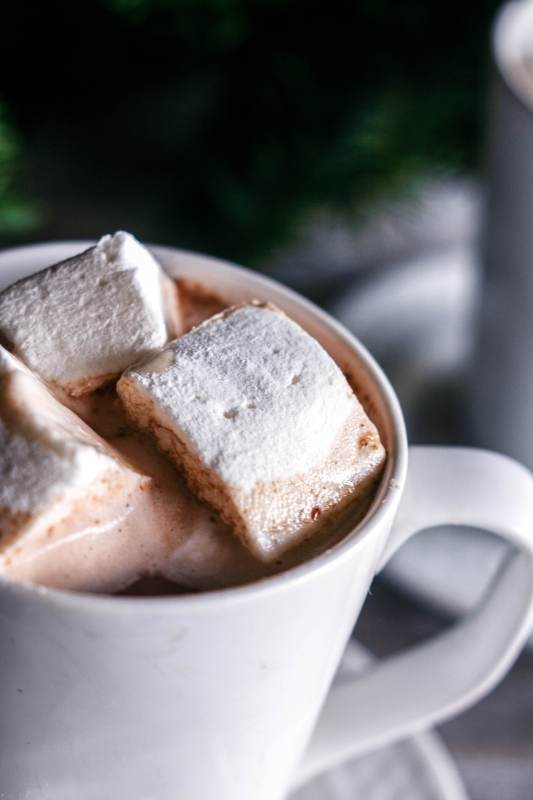 A cup of three minute hot chocolate with three marshmallows on www.sweetteaandthyme.com