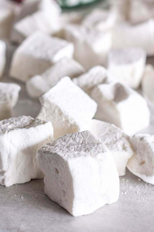 Foolproof Homemade Marshmallows dusted with powdered sugar and cut into cubes on www.sweetteaandthyme.com