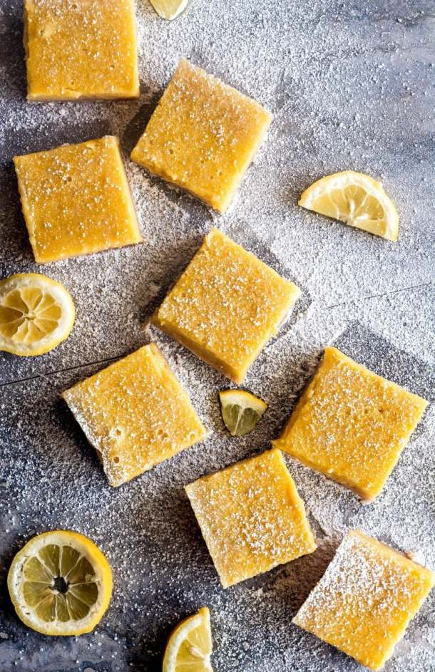 Classic lemon bars with a thick, creamy, bright and zesty lemon filling and soft, sweet, buttery shortbread crust. Perfect for any holiday table, spring brunch, baby shower, or Sunday supper!