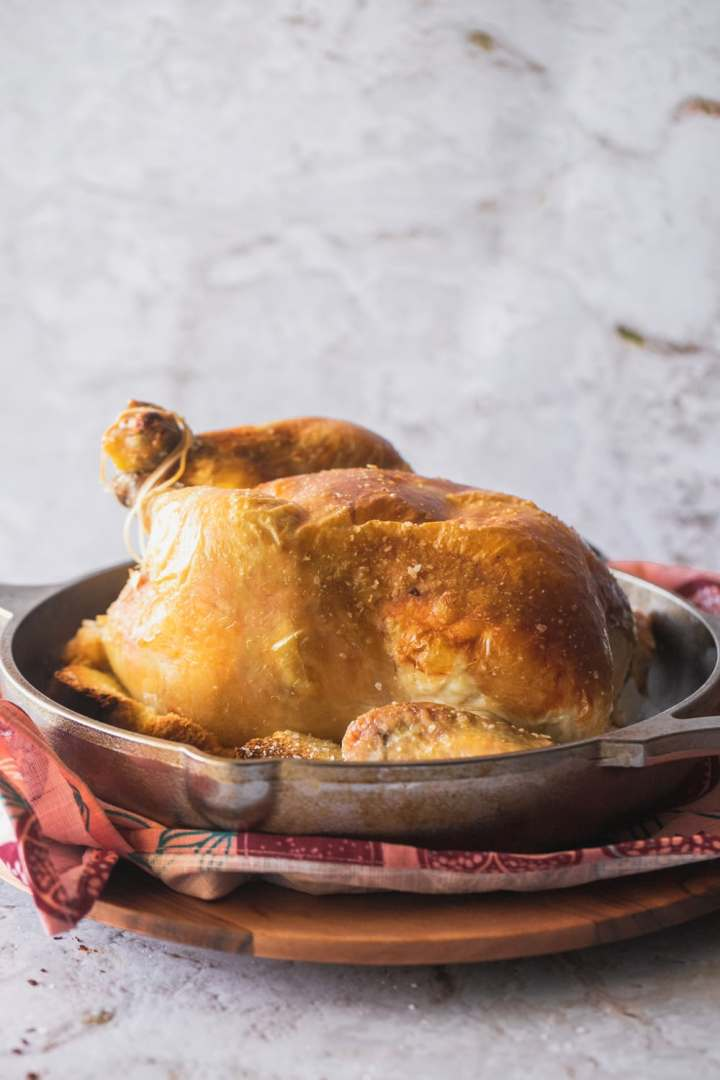 whole chicken roasted until golden brown with crispy skin