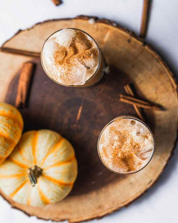 overhead view of two cups of pumpkin cream cold foam in cold brew iced coffee