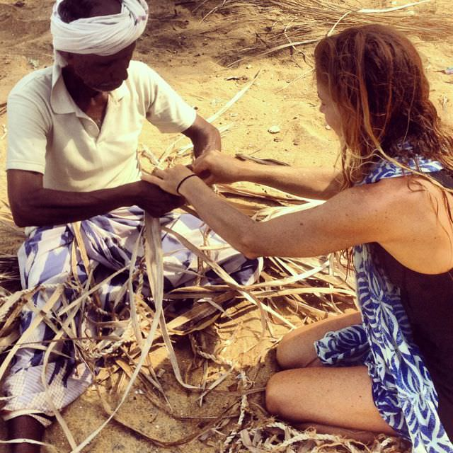 A fisherman teaching me some Indian resourcefulness. We're adding coconut leaves at short intervals along the rope to make it float!