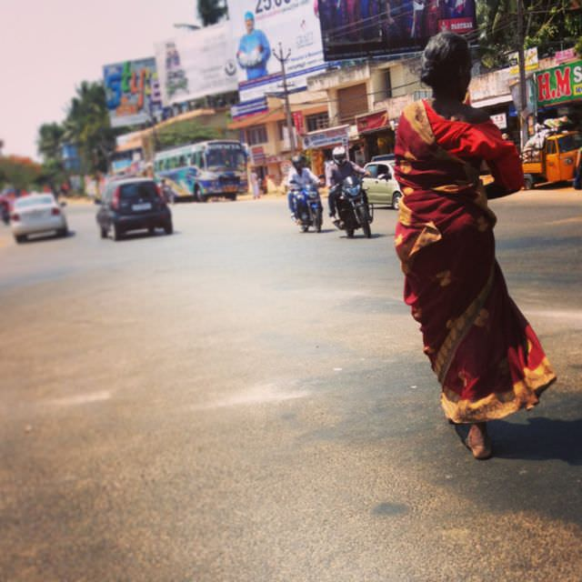 She's beautiful, unphased...barefoot and striding gracefully across the sizzling hot asphalt.