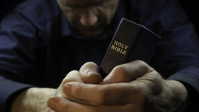 man-praying-bible-1920x1080.jpg