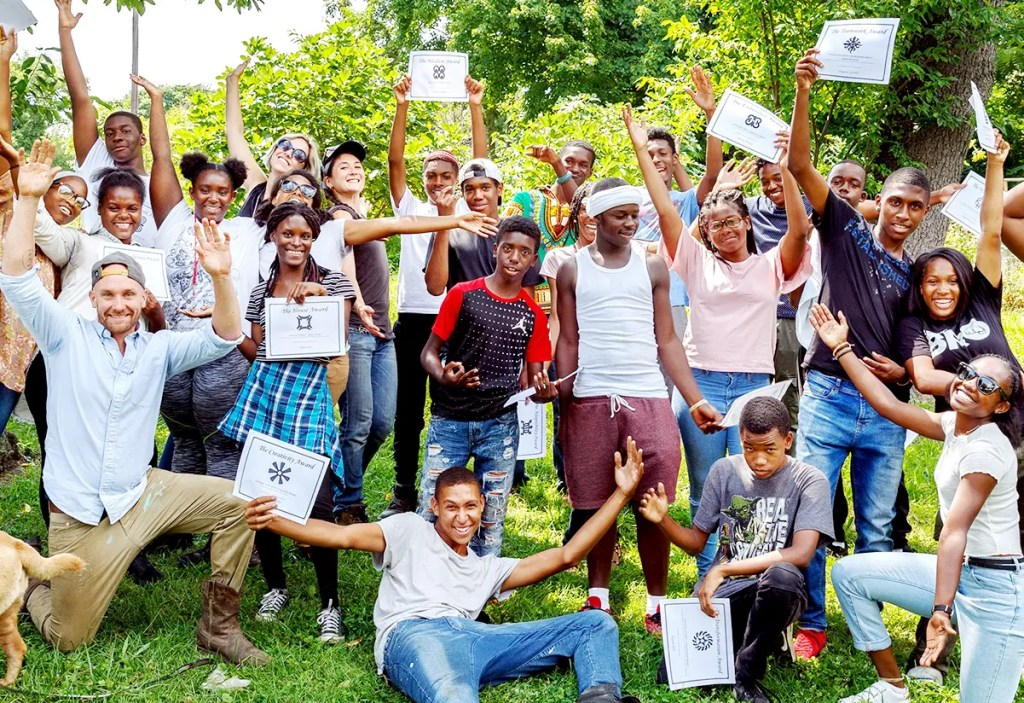 Bartram's Garden youth Volunteers celebrate the end of a successful and productive school year of volunteering in June.  Residents are urged to vote for a grant to support next year's program. Photograph by Alan Brian Nilsen