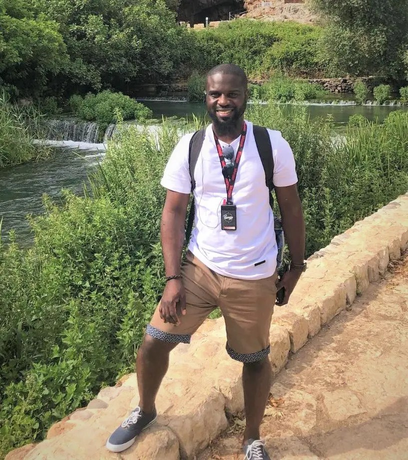 Eugene Burke pauses on a trail by the River Jordan in Israel where he and 150 area Christians visit sites where scripture says Jesus taught and healed.