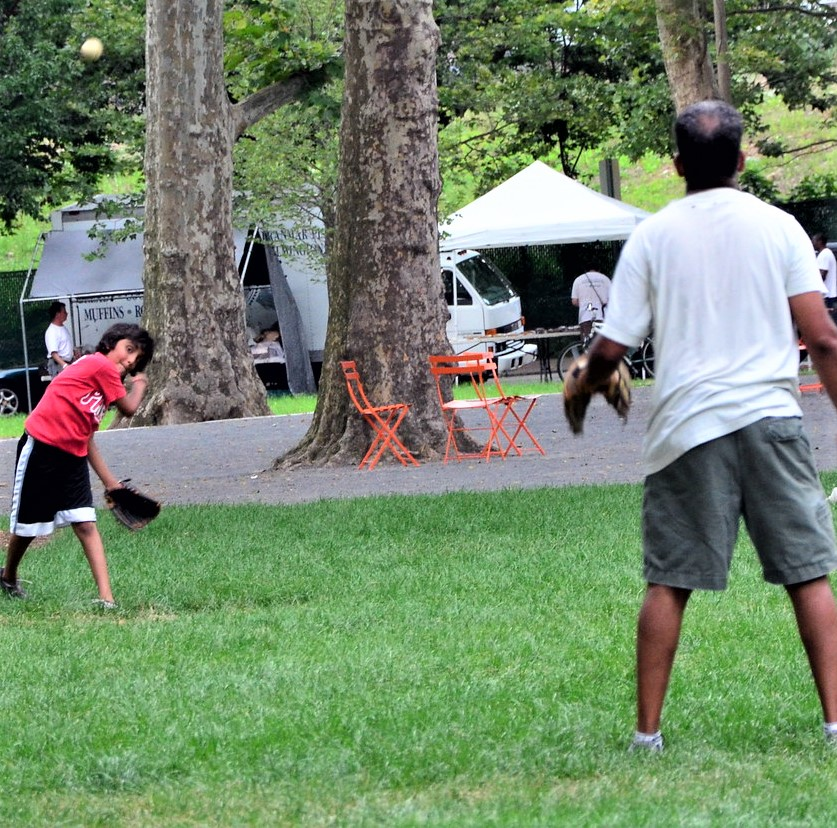 What a great way for fathers and sons to spend a pleasant moment together playing catch on the wide-open grassy spaces at Clark Park during the Woodland Avenue Reunion on the afternoon of September 14!