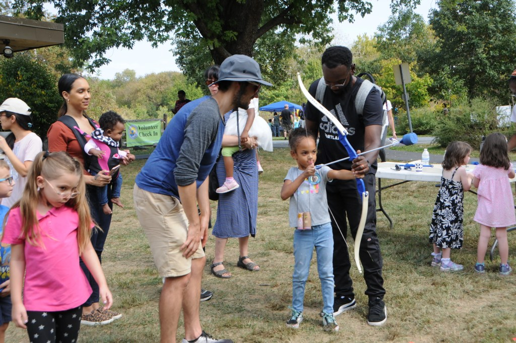 A young archer gets instruction on how to launch arrows safely and accurately at the Fall Festival at Heinz Refuge on September 28.