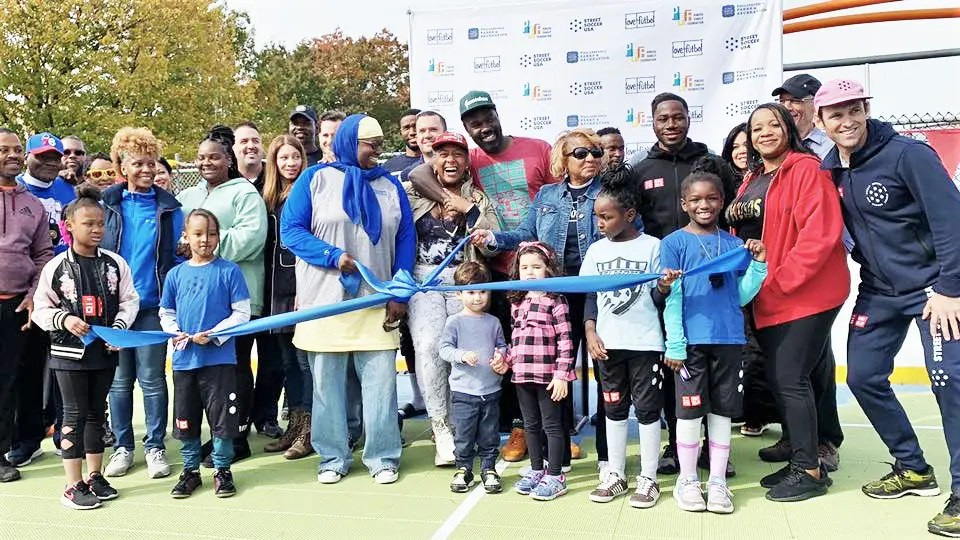 The official ribbon cutting for the new soccer and volleyball court at Finnigan Playground off 70th Street on October 26. The new facility resulted from the efforts of several committed donors, supporters, and over 150 neighborhood volunteers over the past 5 months.