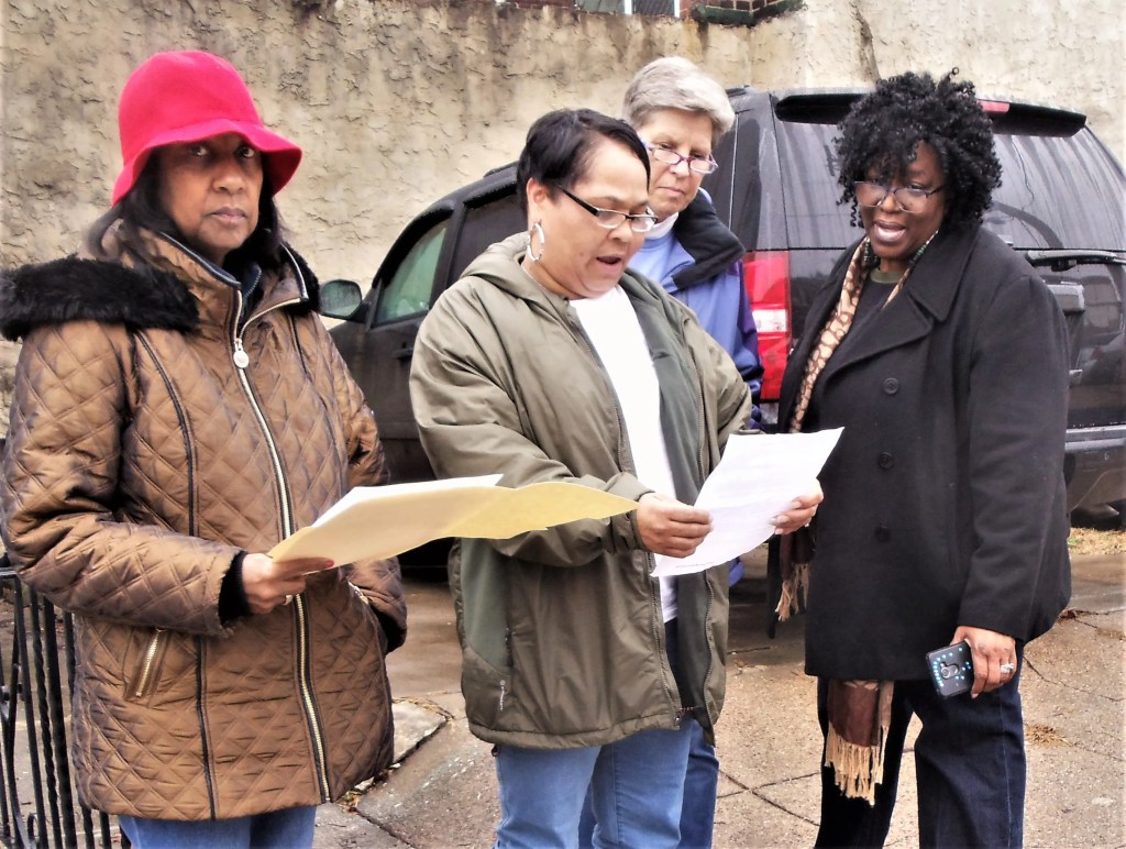 At the site of one of the 30 gun violence deaths in Southwest this past year are Dian Pringle, Theresa Custalow, Buff Barnes, and Diana Douglas. Barnes is the Spiritual Director at The Common Place. The other three ladies are members of the Evangelism team at Grace Christian Fellowship. Following reciting of a litany of remembrance at each location, all prayed to become instruments of God's peace in our battered community.