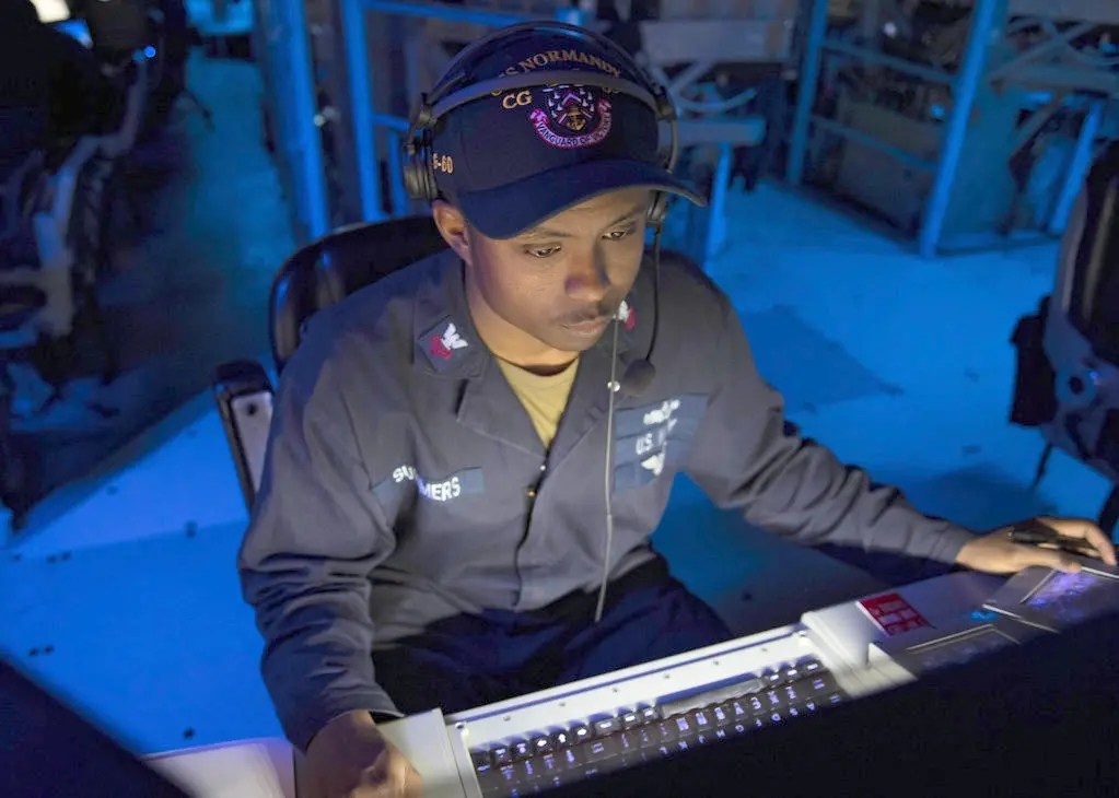 191210-N-PC620-0044rMEDITERRANEAN SEA (Dec. 10, 2019) Operations Specialist 1st Class Khairi Summers, from South West Philadelphia, stands the air intercept controller watch as part of an anti-air warfare exercise aboard the Ticonderoga-class guided-missile cruiser USS Normandy (CG 60) in the Mediterranean Sea Dec. 10, 2019. The Normandy is part of the Harry S. Truman Carrier Strike Group (CSG) and is conducting operations in the U.S. 6th Fleet to support maritime security operations in international waters, alongside our allies and partners. The Harry S. Truman CSG last operated in the U.S. 6th Fleet area operations in 2018, demonstrating its ability to operate from the High North to the East Mediterranean. (U.S. Navy photo by Mass Communication Specialist 2nd Class Michael H. Lehman/Released)