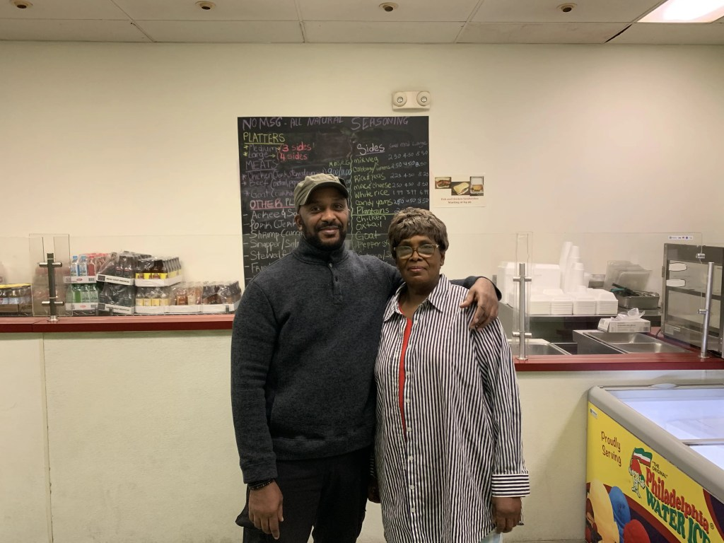 Kirk Evans standing with his mother, Jane Henderson, owner and founder of Jamaica Way.