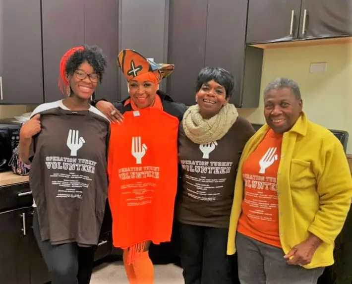 The kitchen team takes a break. Pictured is Andrea Johnson (2nd from right) who organized the Operation Turkey Thanksgiving meal program in Philadelphia for the second year in a row.