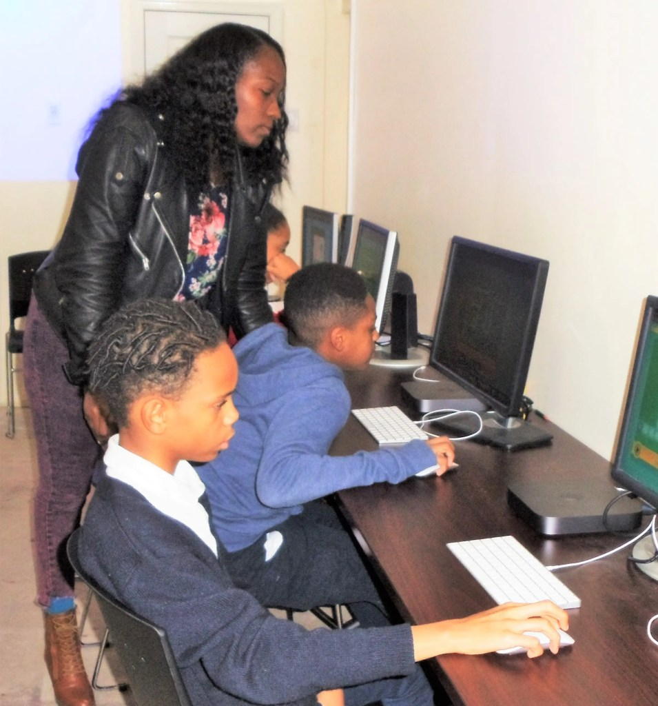 """Under the expert leadership of Fatima Burke, a half dozen """"Common Place Scholars """" practice computer coding after school. What Davene, Chase, Danica, Sapphire, and Amiya are learning this week can build toward school success now and many career choices in the future!"""