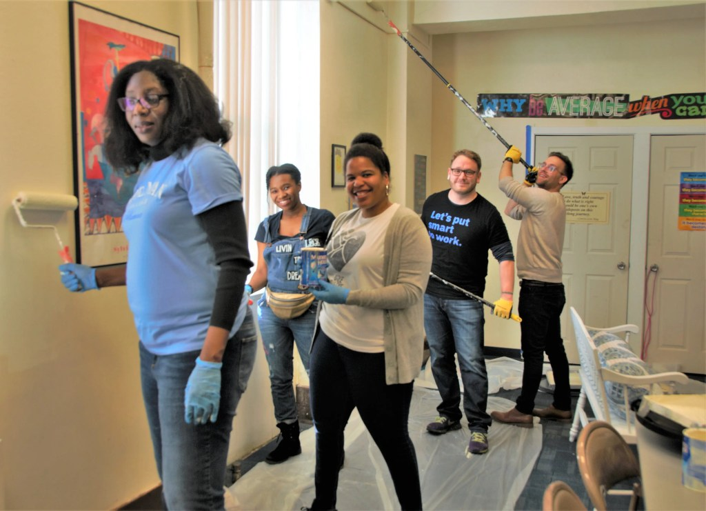 Hard at work painting the walls in the assembly room at The Common Place on MLK Day were Dacia, Layshan, and Jen, all alumnae from Spellman College and James and Steven who work for IBM in Philadelphia. The Common Place is a community center at 58th St. & Chester Ave.