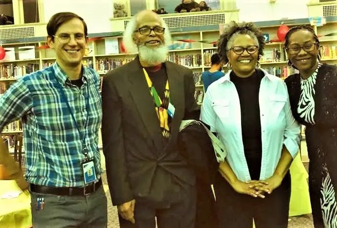 Enjoying the 100th anniversary of the founding of the Kingsessing Library were (from left) librarian Ben Remsen, Taifa Jengaji-El, Conita Pierson, and Rachel Hayes.