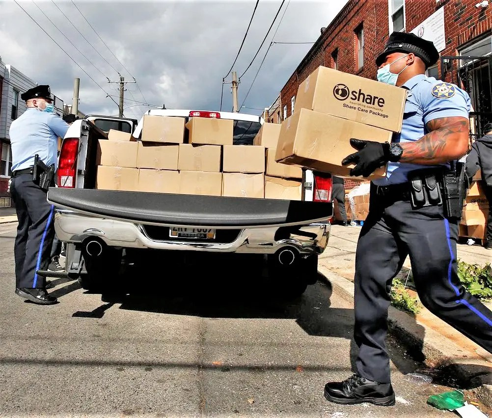 Philadelphia police lend a hand with loading Philabundance supplies for SW free food distribution sites. 12th District ops have been particularly helpful at the SW Senior Center.