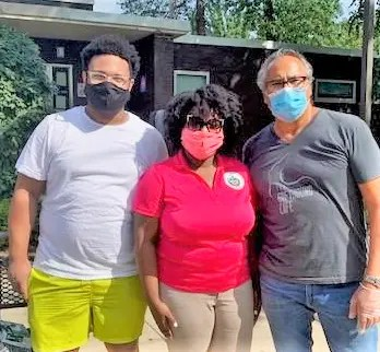Carefully masked for Covid-19 protection, Joseph Solar owner of Greyhound Café in Malvern PA (left)  and his former employee Haakim Peay with State Rep. Joanna McClinton after their distribution of 50 delicious vegan meals to residents of Bartram Village.