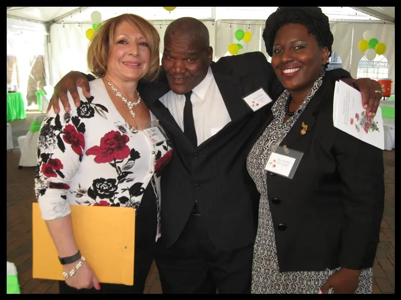 "Paul ""Earthquake"" Moore (center) stands between former State representative Maria Donatucci (left) and State Representative Joanna McClinton (right)."