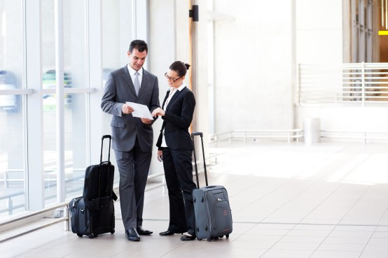 business traveler at airport with insurance
