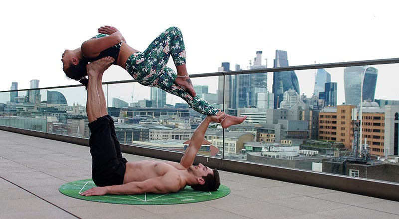 Couple doing crazy yoga pose