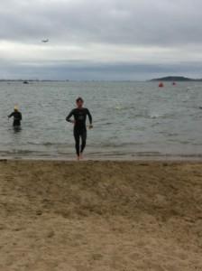 Exiting the swim on Carson Beach at Boston Triathlon