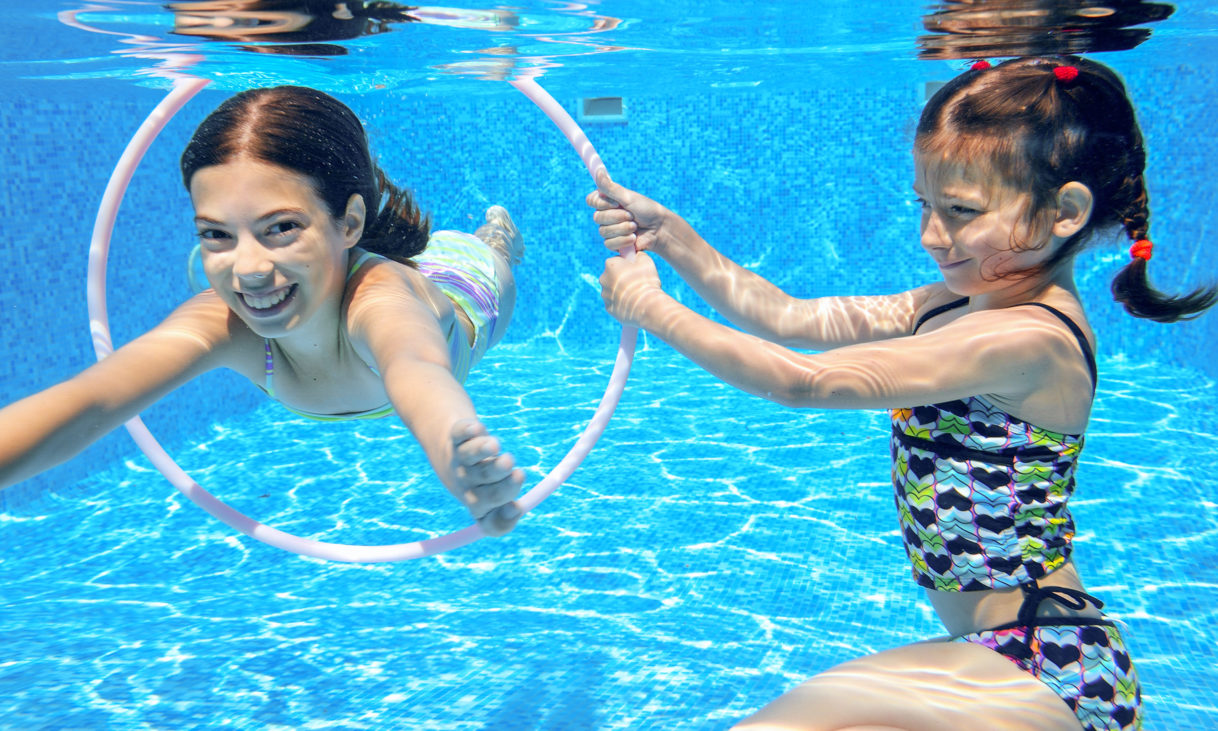 kids swim in pool underwater girls swimming and having fun - Kids Swimming Underwater