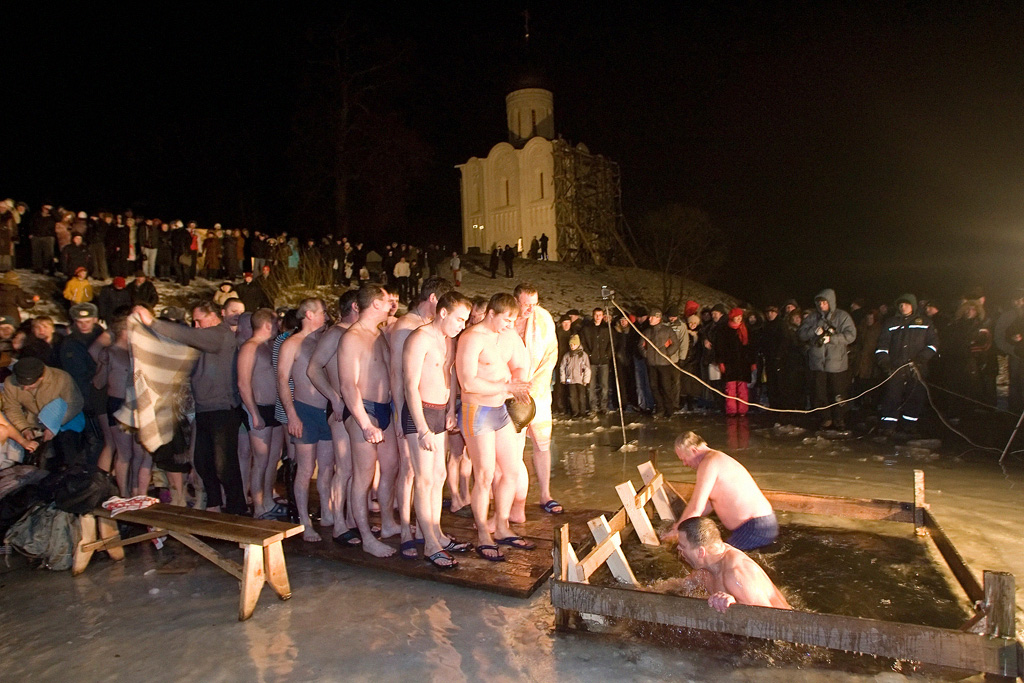 Russians celebrate Epiphany taking ice-cold midnight dip to wash away sins