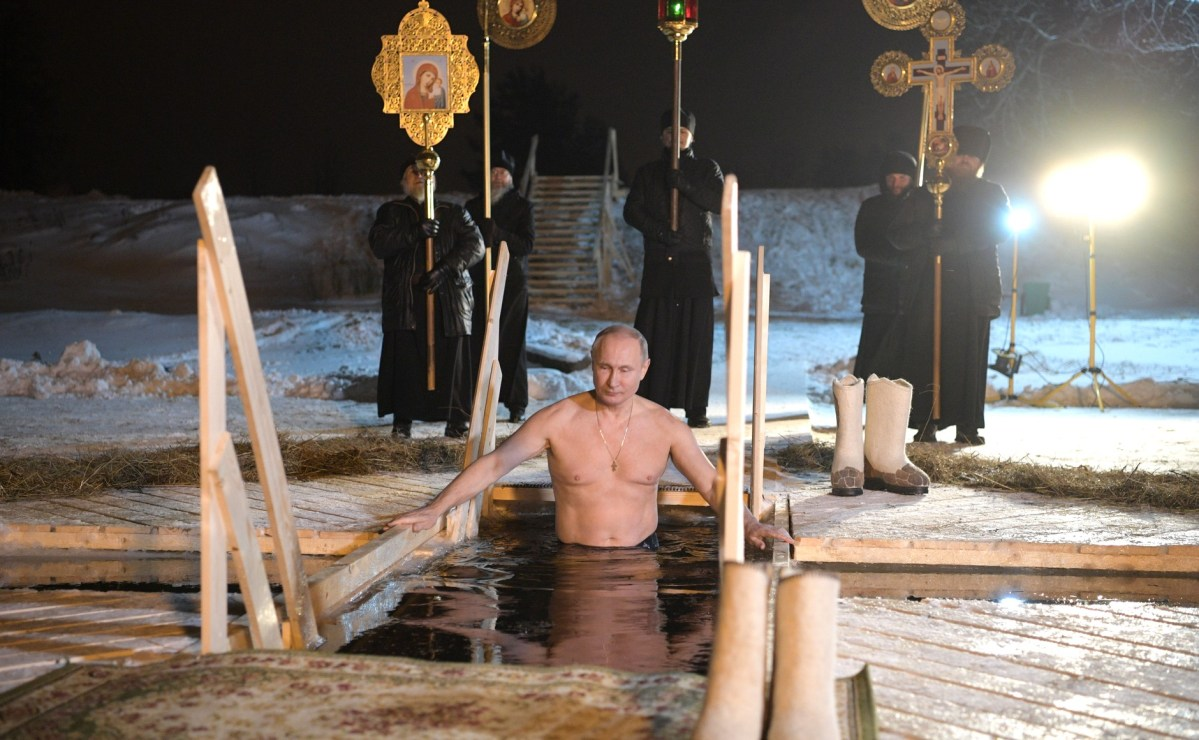 Russia: Nearly nude Putin dips in icy pool to celebrate Orthodox Epiphany in manly-man tradition