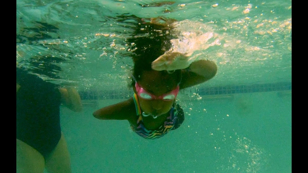 YMCA adaptive program helps girl born without legs learn to swim