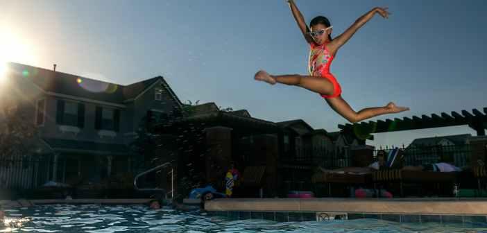 girl jumping on swimming pool