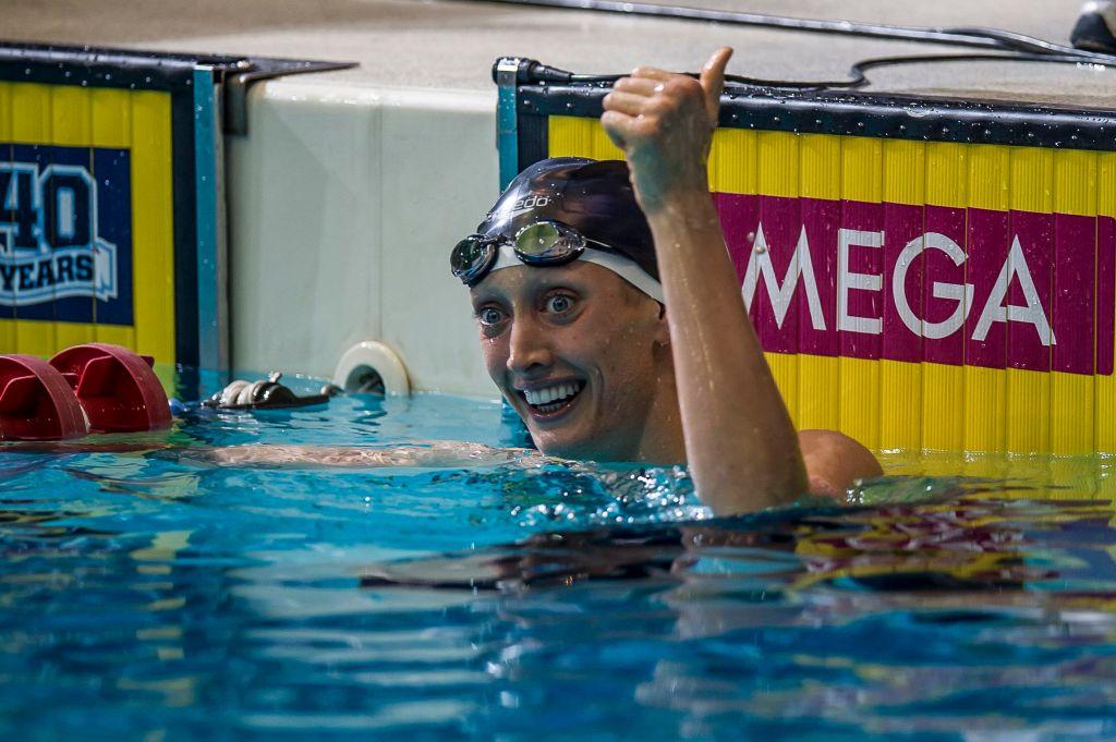 Breeja Larson wins the 100 breaststroke.