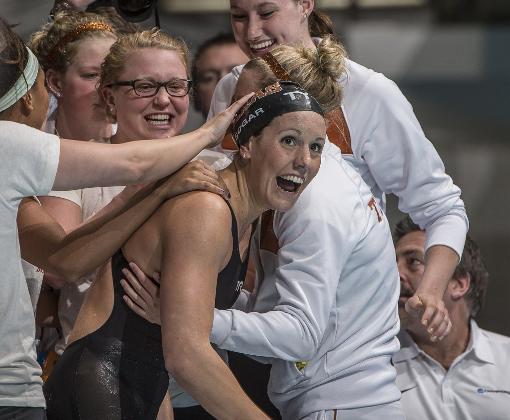 Texas celebrating the 200 breaststroke win by Laura Sogar.