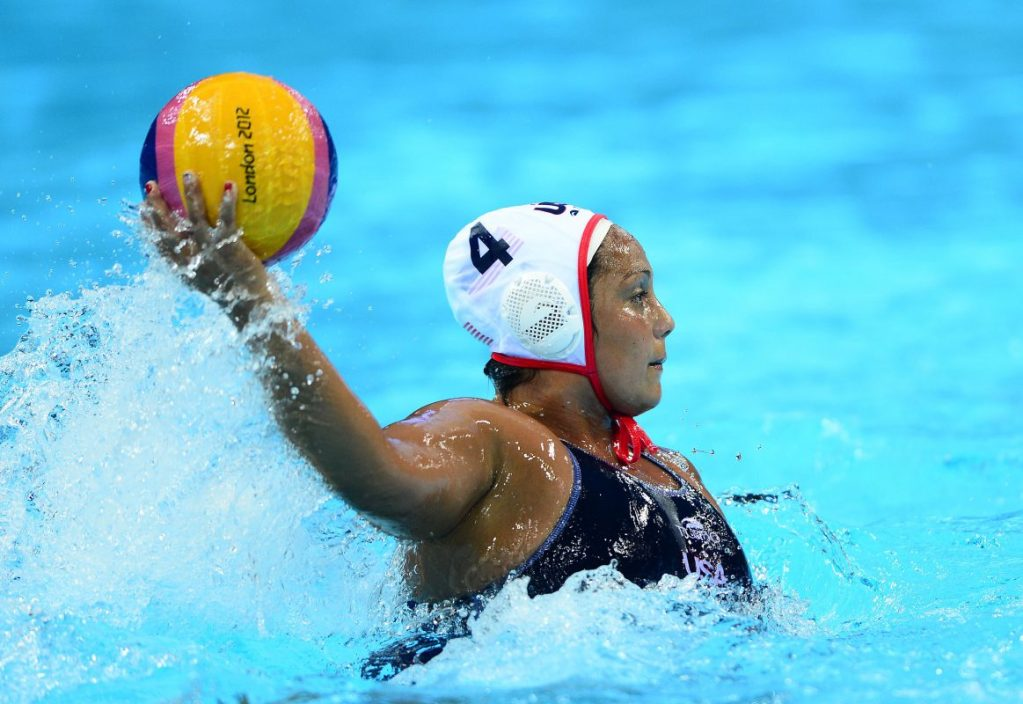 Aug 9, 2012; London, United Kingdom; USA player Brenda Villa (4) throws a pass in the third quarter against Spain in the women's gold medal match during the London 2012 Olympic Games at Water Polo Arena. Mandatory Credit: Andrew Weber-USA TODAY Sports