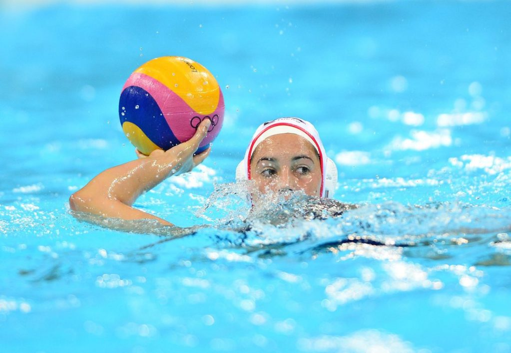 Aug 7, 2012; London, United Kingdom; USA center back Maggie Steffens (6) with the ball in the second quarter against Australia in the women's semifinal in the London 2012 Olympic Games at Water Polo Arena. Mandatory Credit: Andrew Weber-USA TODAY Sports