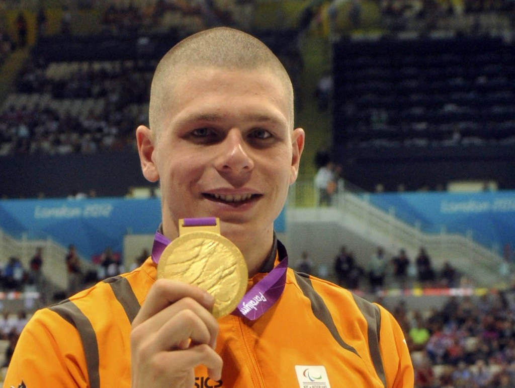 Aug 31, 2012; London, United Kingdom; Marc Evers (NED) poses with his gold medal after receiving it in the men's 100m backstroke - S14 during the London 2012 Paralympic Games at Aquatics Centre. Mandatory Credit: Andrew Fielding-USA TODAY Sports